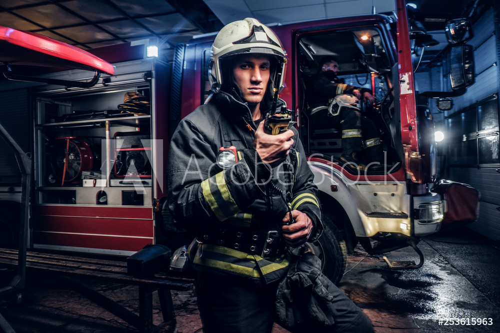 Firefighter communicates via radio