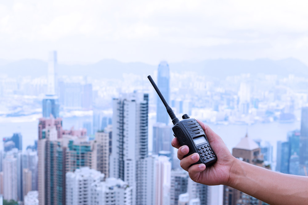 radio in front of skyscrapers