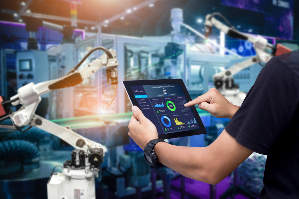 tablet shows monitoring of production that is supported by robot arm